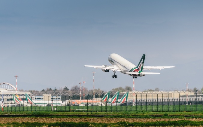 Alitalia commercial airplane takes off from MIlan's Linate Airpo