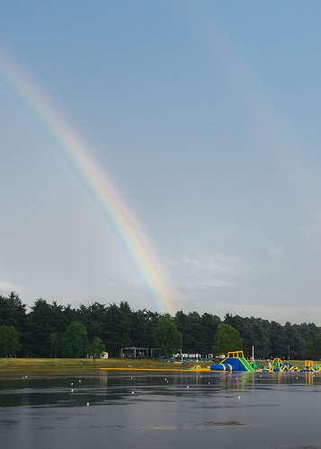 Playground for kids on the water with a rainbow