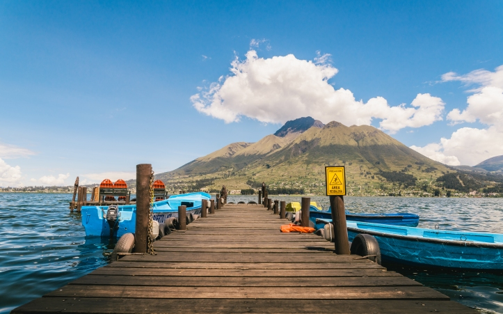 pier on lake with volcano