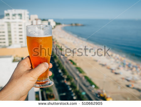 stock-photo-beer-and-rio-de-janeiro-brazil-beach-background-510662905