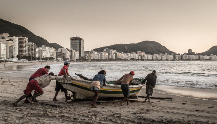 Copacabana at sunrise with fishermen