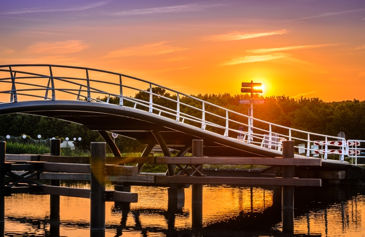 Cycling bridge with sunset