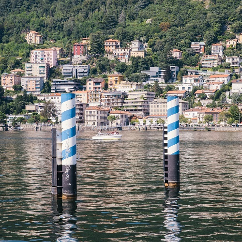 Frame of boat on pier posts at Como in Lake Como, Italy