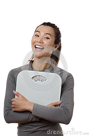 good-bad-happy-female-holding-scales-looking-happy-big-smile-her-face-76403074