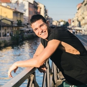 Young handsome man (20-25) chilling out at Milan's, Italy bohemian naviligi district at sunset