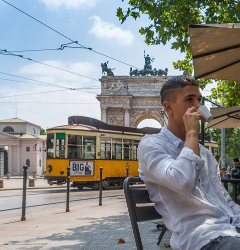 Young man drinking coffee in Milan, italy