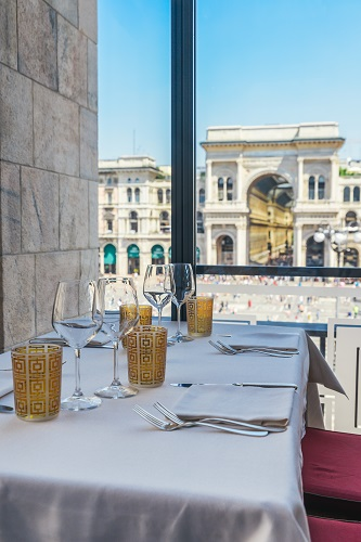 Set empty table overlooking Galleria Vittorio Emanuele II in Milan, Italy