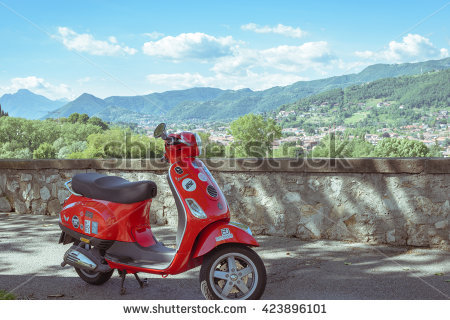 stock-photo-bergamo-italy-may-red-scooter-parked-by-the-wall-in-the-empty-street-post-processed-423896101