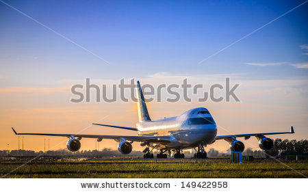 stock-photo-plane-taxing-at-airport-149422958