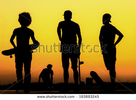 stock-photo-silhouette-of-generation-x-skaters-at-sunset-193893245