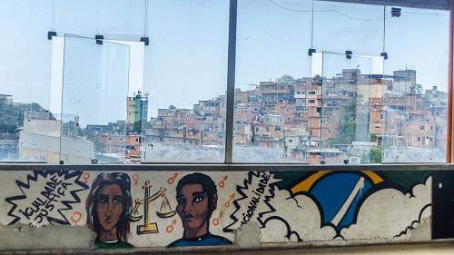 Graffiti overlooking Cantagalo favela in Rio de Janeiro, Brazil