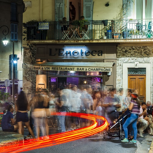 Long exposure of young people drinking in Antibes, Cote d'Azur, France