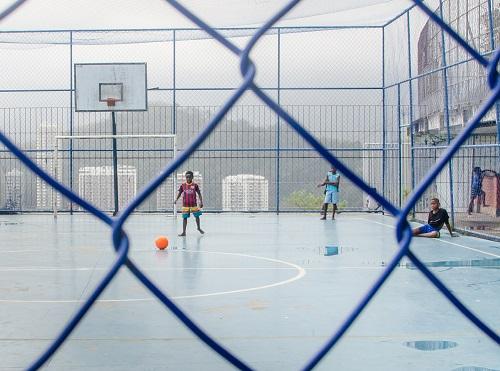 Kids playing football in favela