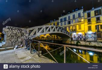 bridge-across-the-naviglio-grande-canal-at-the-evening-in-milan-italy-H7GN45