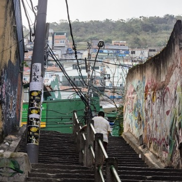 Man going up stairs to favela in Rio de Janeiro, Brazil (2)