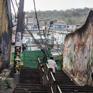 Man going up stairs to favela in Rio de Janeiro, Brazil (2)