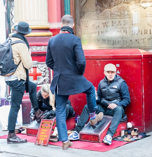 Shoe shiner in London's Leadenhall Market