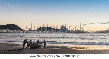 stock-photo-fishermen-at-dusk-in-copacabana-rio-de-janeiro-brazil-690133162