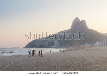 stock-photo-ipanema-beach-in-rio-de-janeiro-brazil-football-on-the-beach-at-sunset-690492283