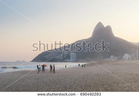 stock-photo-ipanema-beach-in-rio-de-janeiro-brazil-football-on-the-beach-at-sunset-690492283