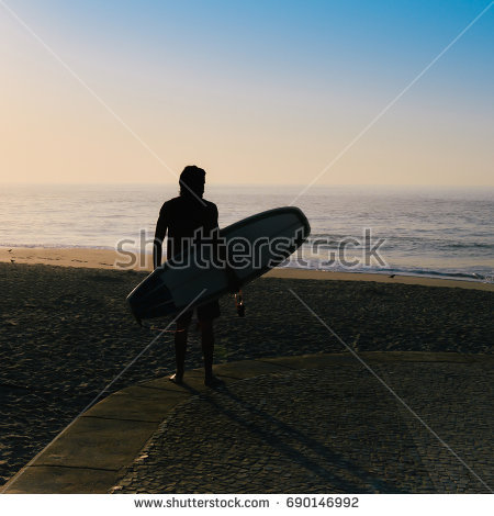 stock-photo-silhouette-of-a-surfer-with-a-surfboard-690146992