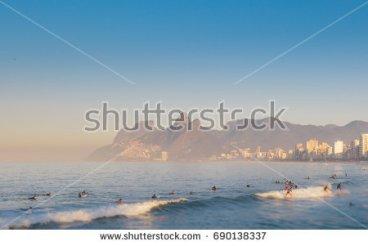 stock-photo-tilt-shift-surfers-in-arpoador-rio-de-janeiro-brazil-690138337