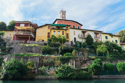 Colourful hillside buildings in Italy with vegetable gardens