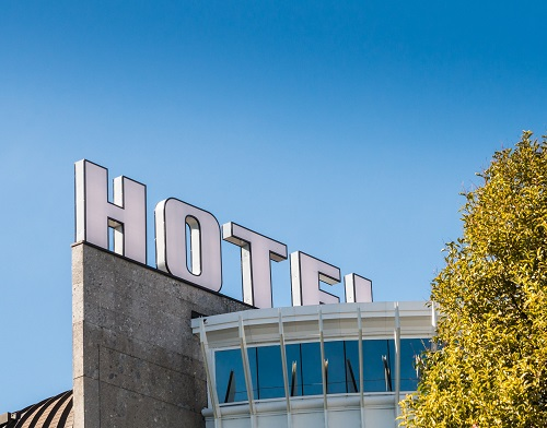 Close up of giant Hotel sign with blue sky
