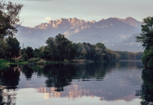 River Adda in northern Italy, close to Lake Como - reflection of Italian Alps