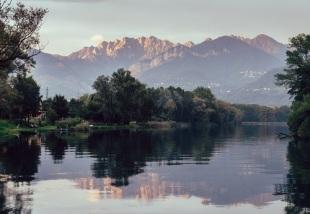River Adda in northern Italy, close to Lake Como - reflection of Italian Alps