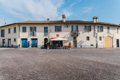 Wide angle view of a quiet street with a cafe in rural Lombardy, Italy