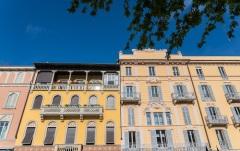Colourful facade of traditional buildings in Como, Italy