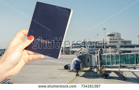 stock-photo-digital-composite-of-hand-holding-a-generic-passport-with-busy-airport-terminal-in-blurred-734161387
