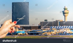 stock-photo-digital-composite-of-hand-holding-a-generic-passport-with-busy-airport-terminal-in-blurred-734161438