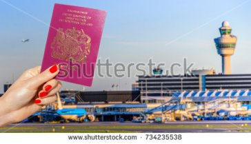 stock-photo-digital-composite-of-hand-holding-a-uk-passport-with-busy-airport-terminal-in-blurred-background-734235538