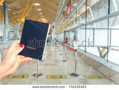 stock-photo-hand-holding-a-generic-passport-just-before-boarding-three-different-lines-group-group-and-734232463