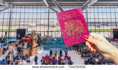 stock-photo-hand-holding-uk-passport-with-busy-airport-waiting-lounge-and-airplanes-in-background-734235550