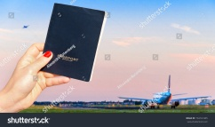 stock-photo-holding-a-generic-passport-with-one-airplane-taxiing-and-another-taking-off-travel-concept-734161405