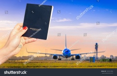 stock-photo-holding-a-generic-passport-with-one-out-of-focus-airplane-taxiing-at-sunset-travel-concept-734161396