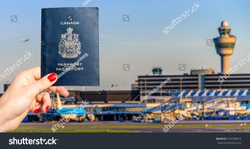 stock-photo-person-holding-a-canadian-passport-with-airport-terminal-background-travel-concept-733769014