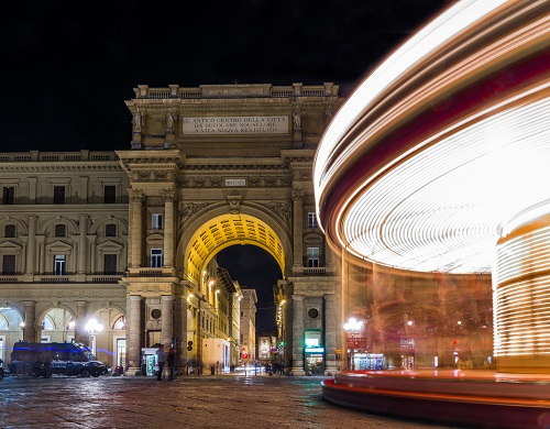 Long exposure of carousel at night in  Florence, Tuscany, Italy