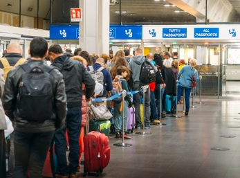 Long immigration queue at Malpensa Airport in Milan, Italy for arrivals of Non-Schengen travellers