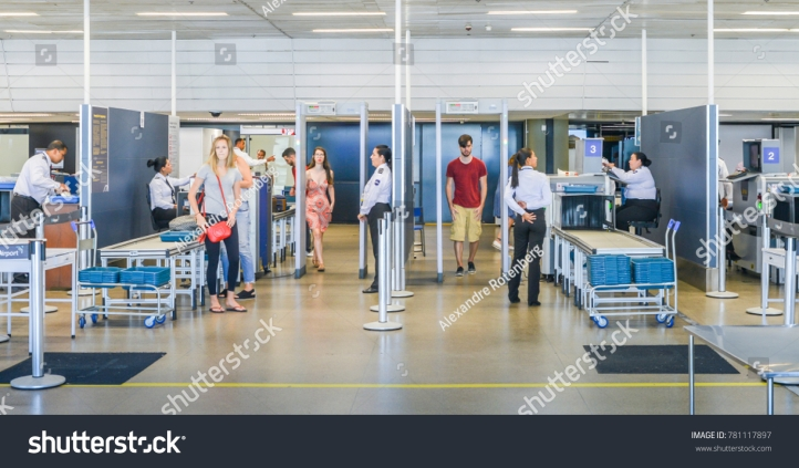 stock-photo-santos-dumont-airport-rio-de-janeiro-brazil-dec-passengers-and-their-belongings-are-781117897
