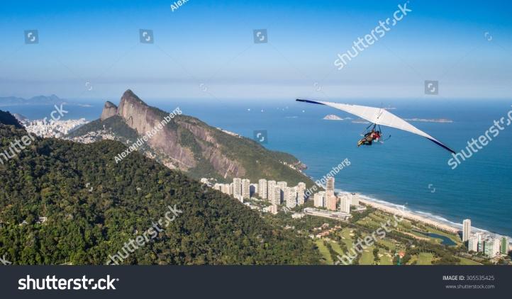stock-photo-rio-de-janeiro-brazil-hang-gliding-flight-305535425