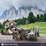 dolomites-italy-september-9th-2017-young-well-dressed-man-30-35-playing-M1550X