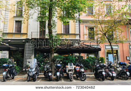 stock-photo-a-street-in-milan-lombardy-italy-against-a-colourful-facade-723040462