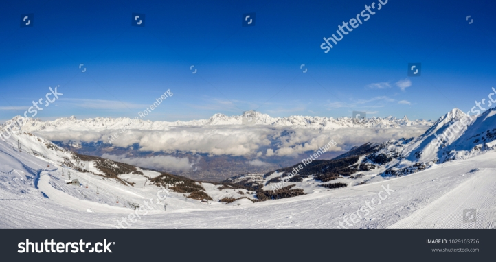 stock-photo-panoramic-view-of-european-alps-during-winter-captured-at-aosta-in-italy-facing-north-towards-1029103726