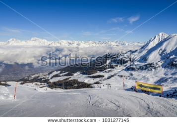 stock-photo-panoramic-view-of-wide-and-groomed-ski-piste-in-resort-of-pila-in-valle-d-aosta-italy-during-1031277145