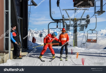 stock-photo-pila-aosta-italy-feb-older-man-and-teenager-get-off-chairlift-at-ski-resort-with-1031277673