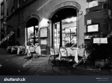 stock-photo-set-tables-on-patio-of-italian-restaurant-in-medieval-alleyway-of-lucca-tuscany-italy-1015914490